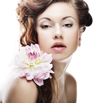 Beautiful woman with big pink flowers