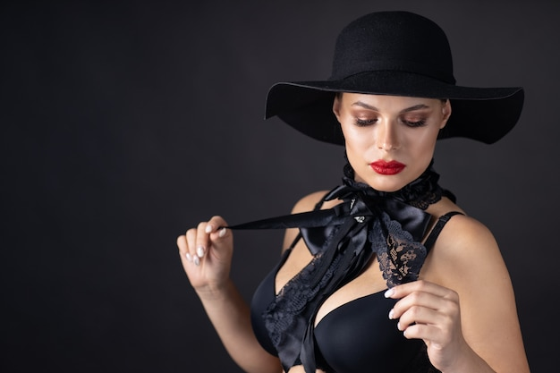 Beautiful woman with a black hat