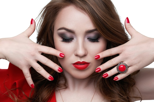 Beautiful woman with blond hair. fashion model with red lipstick and red nails. portrait of glamour girl with bright makeup. beauty female face. perfect skin and make up. red lips and nail polish