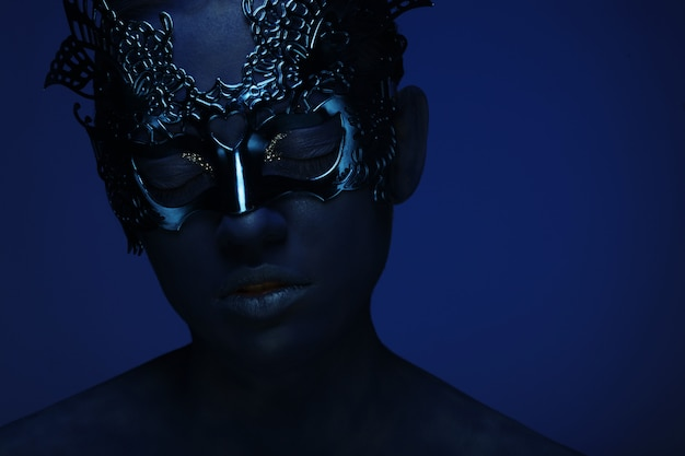 Beautiful woman with blue face with mask