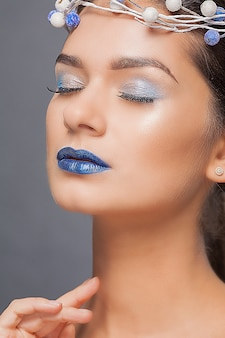 Beautiful woman with blue lips and crown