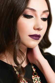 Beautiful woman with bright evening makeup