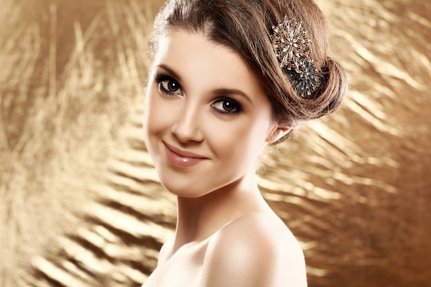 Beautiful woman with brooch in hair