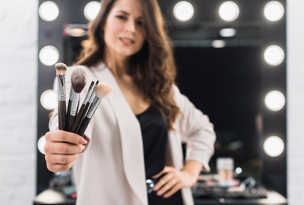 Beautiful woman with brushes in hand