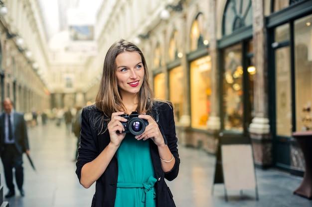 Beautiful woman with a camera