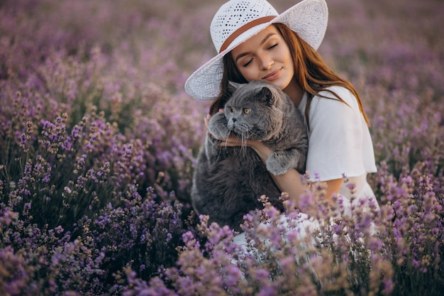 Beautiful woman with cat in a lavander field
