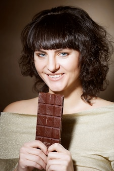 Beautiful woman with a chocolate