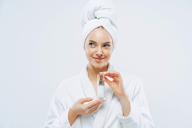 Beautiful woman with clean fresh skin, recommends a cosmetic product