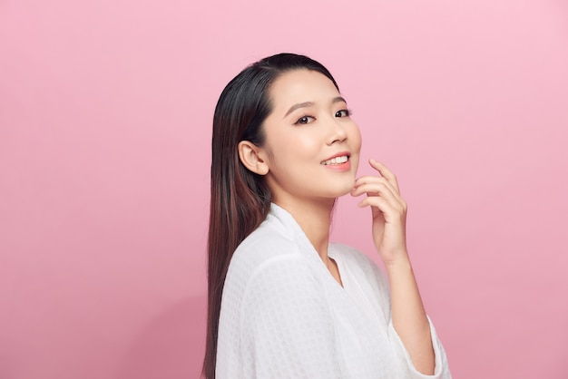 Beautiful woman with clean skin isolated on pink
