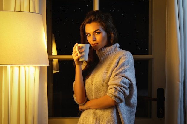 Beautiful woman with a cup of hot drink