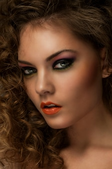 Beautiful woman with curls and makeup