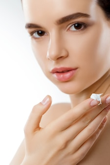 Beautiful woman with face cream. skin protection. skincare. spa.