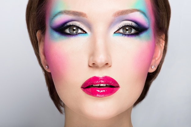 Beautiful woman with fashion bright makeup of eyes and sexy red lips