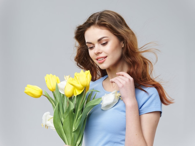 Beautiful woman with flowers bouquet
