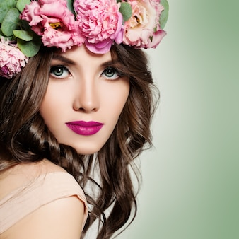 Beautiful woman with flowers wreath.