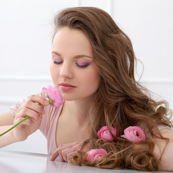 Beautiful woman with flowers
