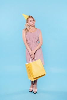 Beautiful woman with gift bags