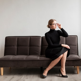 Beautiful woman with glasses on couch