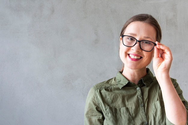 Beautiful woman with glasses smiling