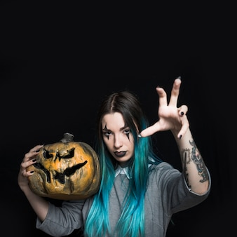 Beautiful woman with halloween pumpkin