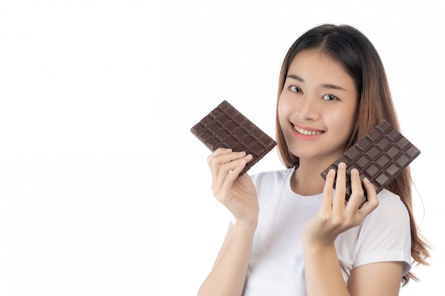 Beautiful woman with a happy smile holding a hand chocolate