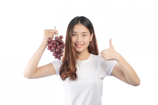 Beautiful woman with a happy smile holding a hand grape, isolated on white background.