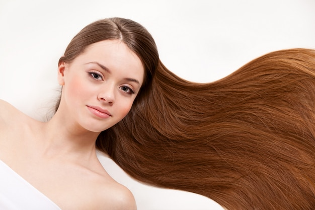 Beautiful woman with her long brown hair