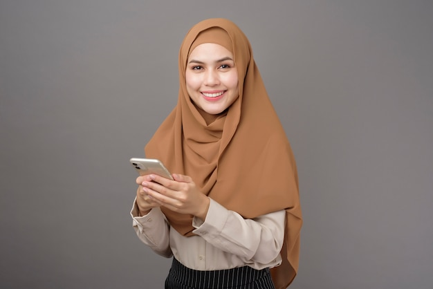Beautiful woman with hijab using the phone