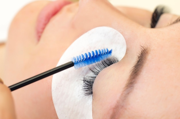 Beautiful woman with long eyelashes in a beauty salon