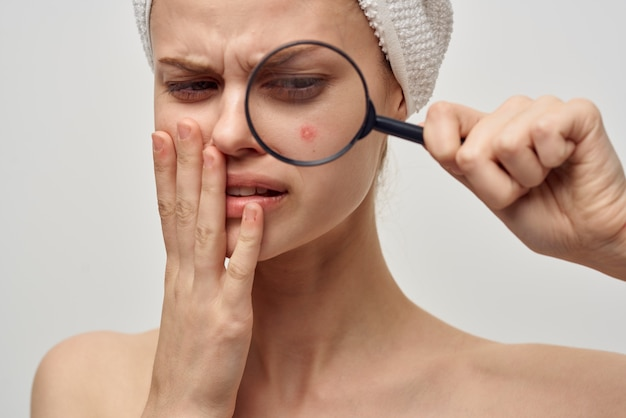 Beautiful woman with a magnifying glass in hand hygiene treatment