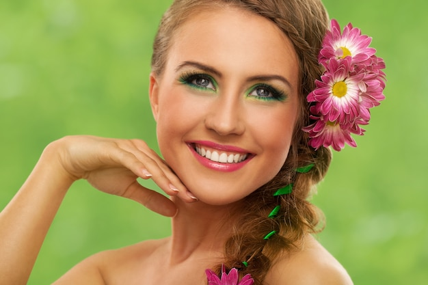 Beautiful woman with makeup and flowers
