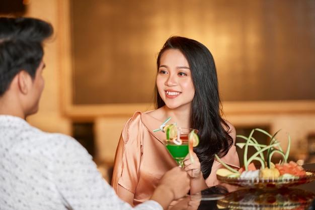 Beautiful woman with man in saloon
