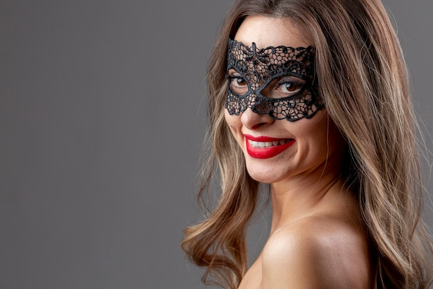 Beautiful woman with mask smiling