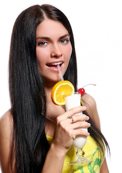 Beautiful woman with milkshake cocktail