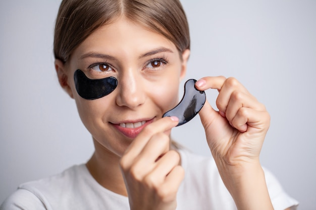 Beautiful woman with natural makeup and black patches under her eye