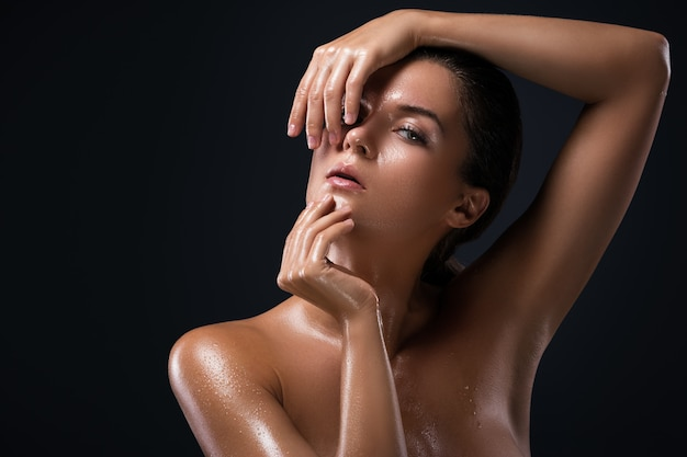 Beautiful woman with oily and wet skin