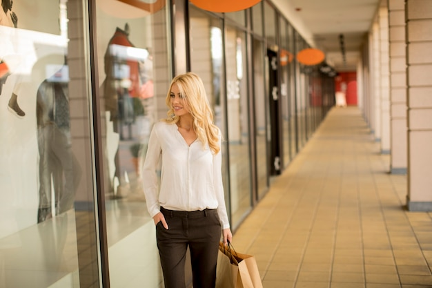 Beautiful woman with paper shopping bag