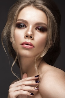 Beautiful woman with perfect skin and evening make-up
