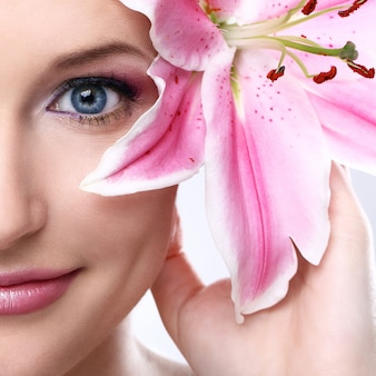 Beautiful woman with pink lily flower