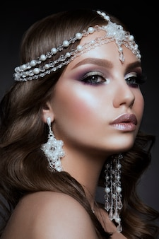 Beautiful woman with professional make upwoman with tiara on her hed