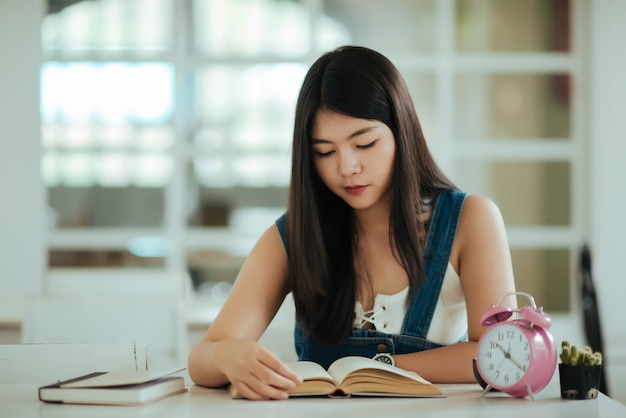 Beautiful woman with reading book