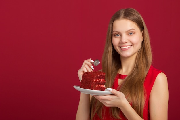 Beautiful woman with a red velvet cake