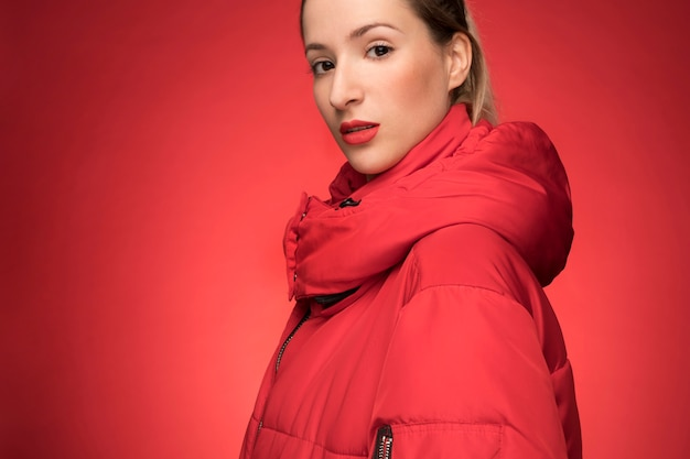 Beautiful woman with red winter jacket