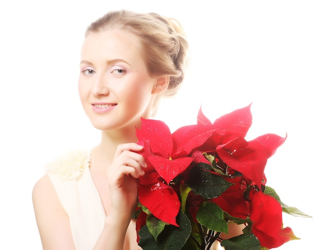 Beautiful woman with red xmas flowers over white