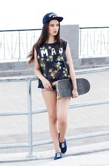 Beautiful woman with skateboard