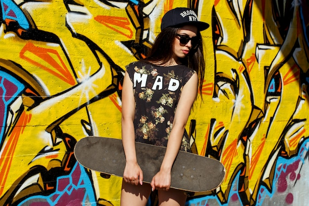 Beautiful woman with skateboard
