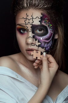 Beautiful woman with skeleton make up