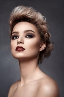 Beautiful woman with smokey eyes make-up