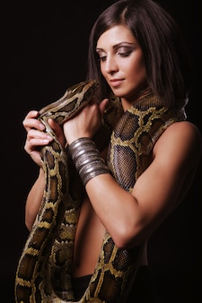 Beautiful woman with a snake