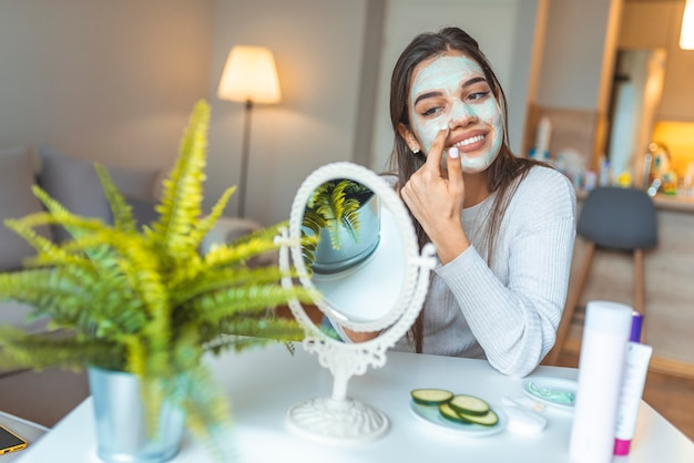 Beautiful woman with spa facial mask.